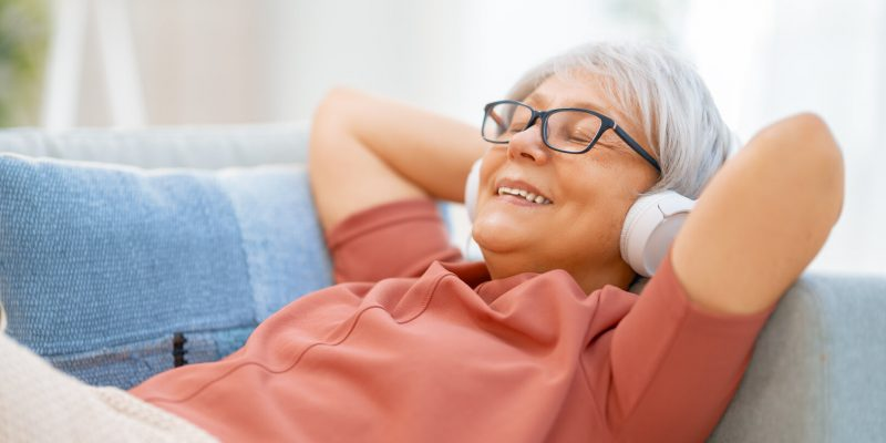 Senior woman listening to music